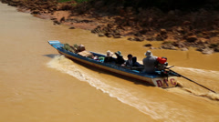 Boat with people floats on the river to the Tonle Sap lake in Cambodia Stock Footage