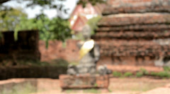 Dismembered buddha statue at the ruins of Ayutthaya Stock Footage