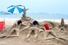 rio de janeiro, march 2: in bad weather, only sand sculpture sunbathe on the - stock photo