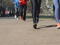 People jogging in park, slow motion shot at 240fps, steadycam shot Stock Footage