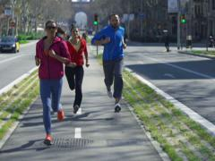 People jogging on the street, slow motion shot at 120fps, steadycam shot Stock Footage