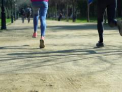 Women jogging in park, slow motion shot at 240fps, steadycam shot Stock Footage