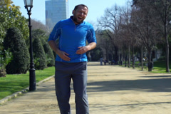 Jogger having muscle contraction, slow motion shot at 60fps, steadycam shot - stock footage