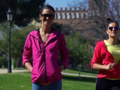 Woman smiling to the camera in park, slow motion shot at 240fps, steadycam shot Stock Footage