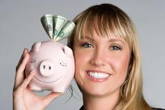 piggy bank woman - stock photo