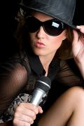 Microphone singing woman Stock Photos