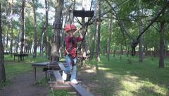 Child Climbing in Forest Sliding Down, Adventure Park, Children, Extreme Sport Stock Footage