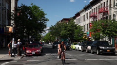 Stock Video Footage of Franklin Avenue Crown Heights. Brooklyn Stores. Hipster on a bike in Brooklyn.