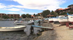 Bulgaria Nessebar waterfront with boats in water Stock Footage