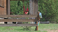 Village courtyard and home-made basin on fence Stock Footage