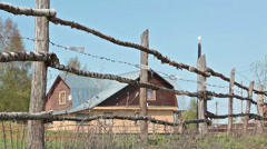 Country wooden fence and house on background, Russian village - stock footage