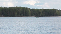 Man in rowboat on the middle of big lake, Karelia, Russia - stock footage