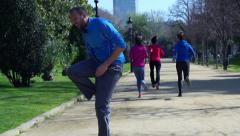 Jogger having muscle contraction, slow motion shot at 60fps, steadycam shot Stock Footage