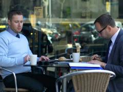 Businessmen working on a tablet and cheking documents in a cafe Stock Footage