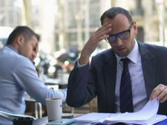 Businessman looking at bad results in documents,sitting the cafe in a city Stock Footage