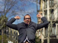 happy businessman running towards the camera and jumping up with happiness - stock footage