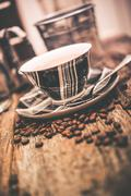 coffee and beans. elegant tartan design coffee cup and coffee beans on wooden - stock photo