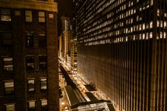 Wall of downtown chicago at night. golden color grading. train route and stre Stock Photos