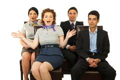 Amazed business people on chairs Stock Photos