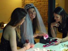 Young woman opening a gift at the bachelorette party, slow motion shot at 60fps Stock Footage
