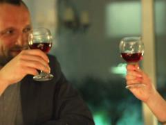 Couple making a toast with glasses of wine during a romantic evening Stock Footage