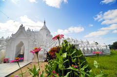 Beautiful flower at white pagoda of hsinbyume  paya temple Stock Photos