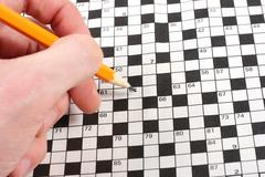 hand doing crossword - stock photo