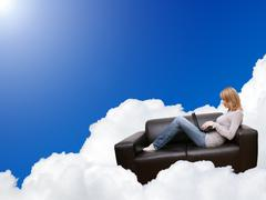Woman relaxing with laptop in couch on the cloud Stock Illustration