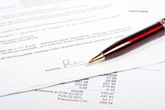 Pen and business contract with signature Stock Photos