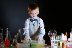 Young physicist experimenting with the reagents Stock Photos