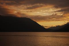 sunset sky over the lake. lake crescent, washington, usa. sunsets photo colle - stock photo