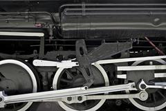 steam locomotive closeup - steam locomotive wheels. historic railroad theme. - stock photo