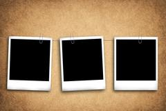 Blank photo frames on a grungy background Stock Photos