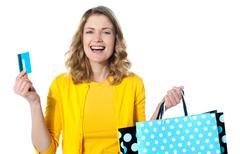 Stock Photo of Happy shopaholic female laughing