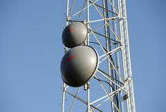communication tower (partial) with two dish antennas. communication and techn - stock photo