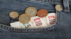 Close up shot of a jeans pocket with pound sterling money Stock Footage