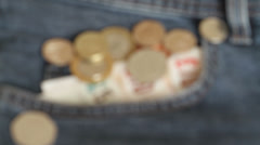 Close up shot of a jeans pocket with pound sterling money - stock footage