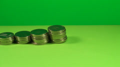 Stack Of Coins On A Green Screen, Chroma, Economy, Currency, Pan Shot - stock footage