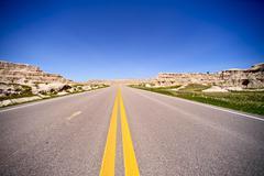 south dakota highway, usa. highway through badlands landscape. single lane ro - stock photo