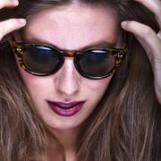 Fashion portrait of young and stylish woman Stock Photos