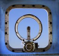 old military war ship window against blue sky background use for multipurpose - stock photo