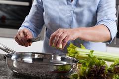 Woman preparing food Kuvituskuvat