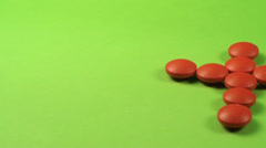 A Cross Made Out Of Red Pills On A Green Screen, Medical, Chroma, Drug Pan Shot Stock Footage