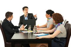 Manager argue employee at meeting - stock photo