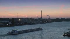 Barge on Amstel River at sunset Stock Footage