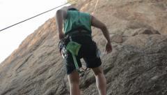 Man Rock Climbing Stock Footage