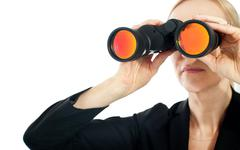 Stock Photo of Businesswoman looking through binoculars