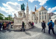 view of st. stephen statue and matthias church - stock photo