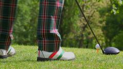 Golfer addresses the ball Stock Footage