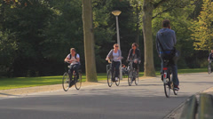 People cycling in a park of Amsterdam Stock Footage